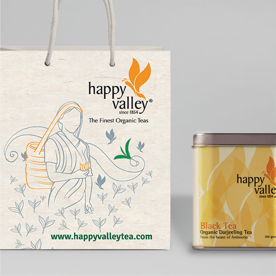 https://wysiwyg.co.in/sites/default/files/worksThumb/Ambootia-happy-valley-garden-packaging-paper-bag-2017.jpg