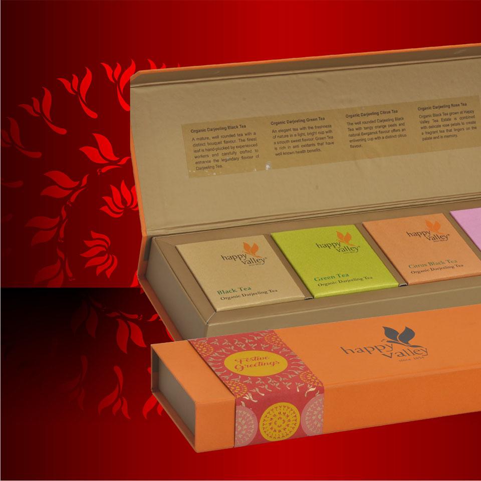 https://wysiwyg.co.in/sites/default/files/worksThumb/Ambootia-happy-valley-tea-packaging-box-festive-durga-puja-2017.jpg